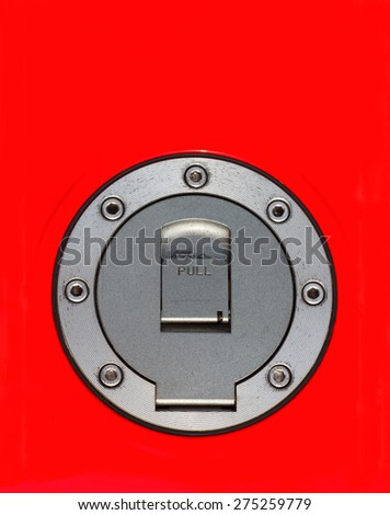Top view of fuel cap of motorcycle in red gas tank - stock photo