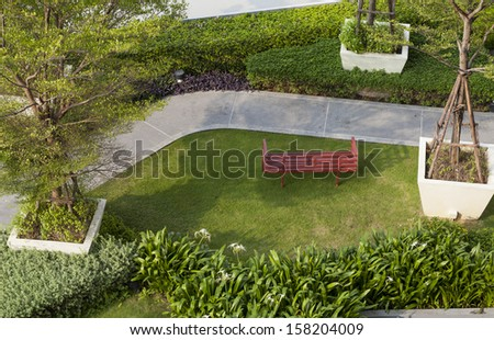 Top view of garden with a bench.