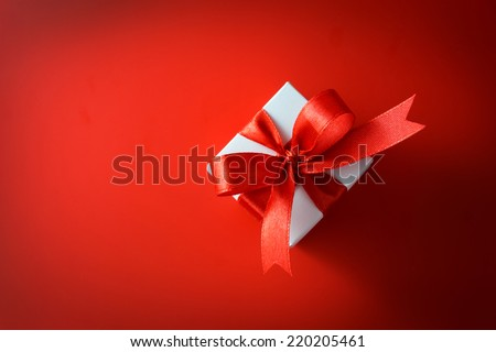 Top view of gift box on red background - stock photo