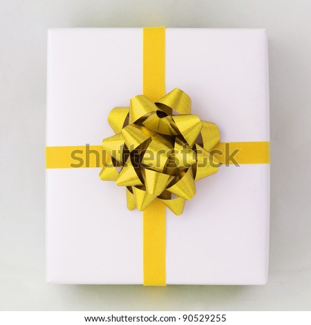 Top view of Gold star and Cross line ribbon on White paper box, Gift for Special Day - stock photo