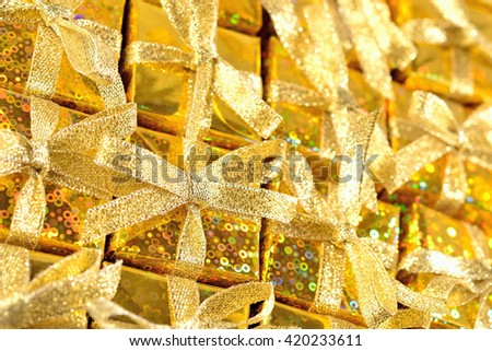Top view of golden gifts close-up as background