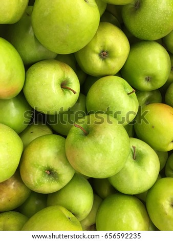 Top view of green apples in pile