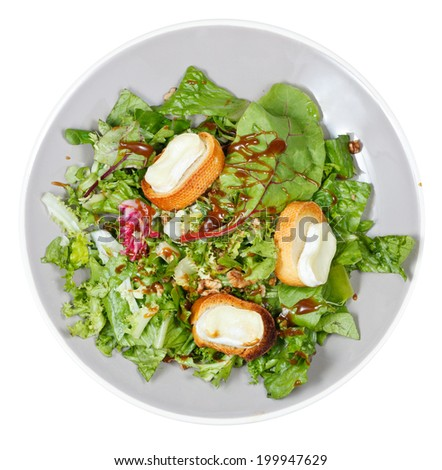 top view of green salad with goat cheese on plate isolated on white background - stock photo