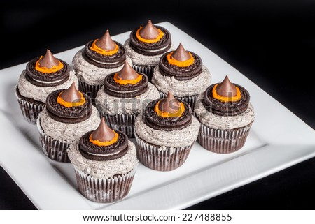 Top view of Halloween cupcakes with witches' hats on top - stock photo