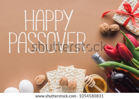 Top view happy passover greeting matza stock photo royalty free top view of happy passover greeting and matza on brown passover tale concept m4hsunfo Image collections