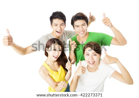 top view of happy young group  with thumbs up - stock photo