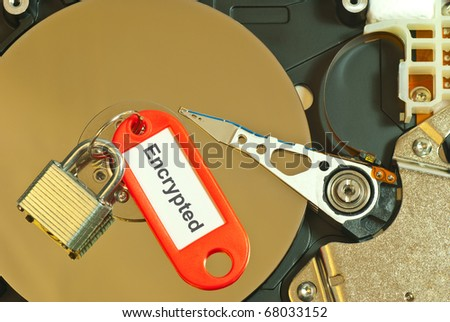 top view of hard disk internal parts with lock and label symbolizing encryption and data security. Available clipping path for the label text area. - stock photo