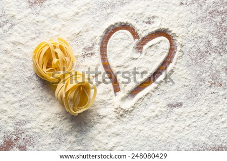 top view of heart and pasta - stock photo