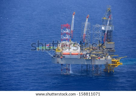 Top view of helicopter pick up passenger on the offshore oil rig. - stock photo