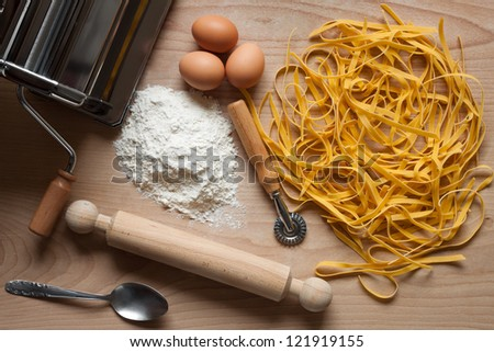 Top view of homemade egg pasta with some ingredients - stock photo
