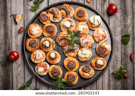 Top view of homemade mini pizza appetizers - stock photo