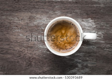 Top view of hot coffee cup on wooden table