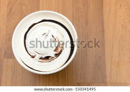 Top view of ice cream cup on the wooden table - stock photo