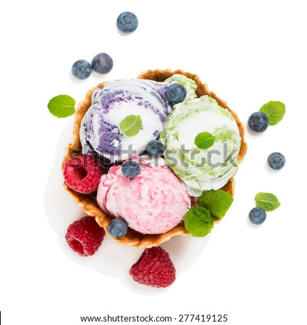Top view of ice cream in a wafer bowl  and fresh  blueberry and raspberry isolated on white background - stock photo