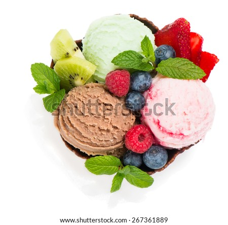 Top view of ice cream with fresh berries in a wafer bowl, decorated with mint isolated on white background - stock photo