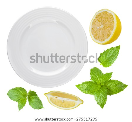 Top view of isolated white plate with lemon and mint - stock photo