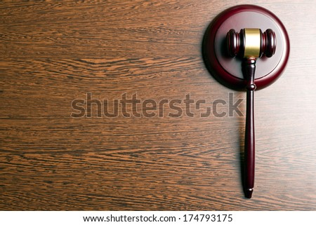top view of judge gavel on wooden background - stock photo