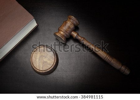 Top View Of Judges Gavel, Red Law Book On The Black Wood Background, Conceptual Image - stock photo