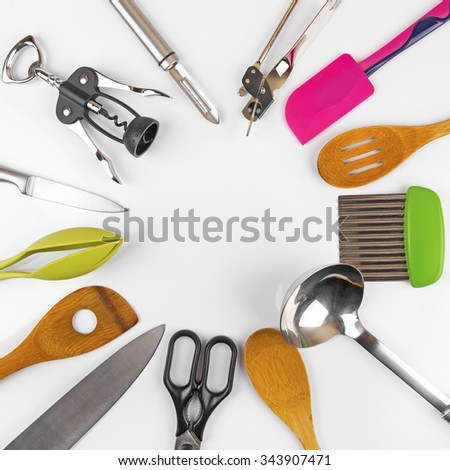 top view of kitchen utensils with blank space in the middle - stock photo