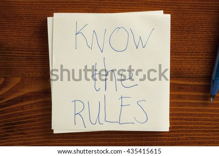 Top view of Know the rules written note on the wooden desk. - stock photo