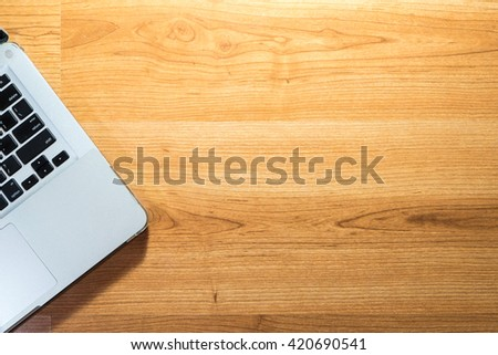 Top view of laptop on wood table - copyspace - stock photo