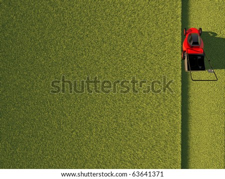 Top view of lawn mower on green field - stock photo