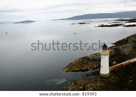 Top view of Lighthouse in Scotland on a Rock near water - stock photo