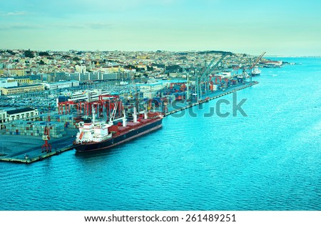 Top view of Lisbon Industrial port at sunset. Portugal - stock photo