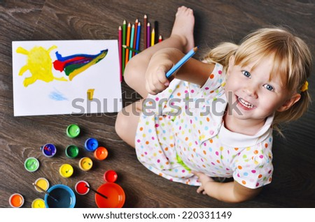 Top view of Little Girl Painting. - stock photo