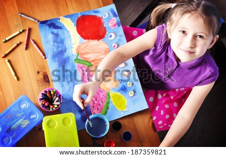 Top view of Little Girl Painting. Little Artist. - stock photo