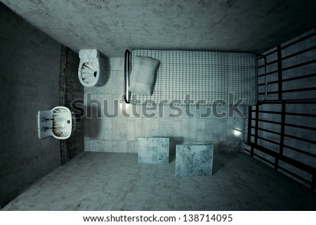 Top view of locked old prison cell for one person with bed, sink, toilet and chair. Dark atmosphere. - stock photo