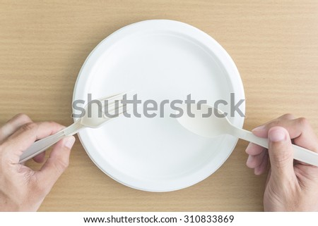 top view of man hand with empty plate