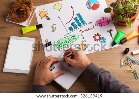 Top view of man hand writing in notebook. financial worker analyzing statistical data on desk in office. top view. above view. Accounts concept.