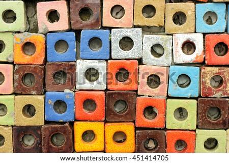 Top view of many colorful ceramic cube art blocks with circle hole at public park, Ratchaburi, Thailand. - stock photo