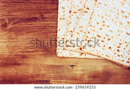 top view of matzoh (jewish passover bread) over wooden background.  - stock photo