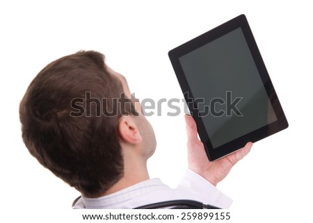 Top view of medical doctor hand holding tablet pc with empty screen / Isolated over white background - stock photo