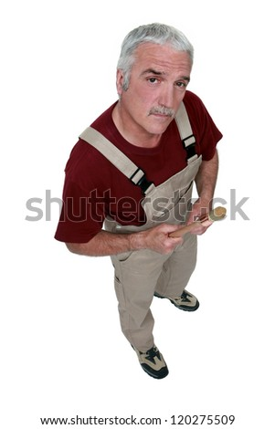 Top-view of middle-aged painter holding brush - stock photo