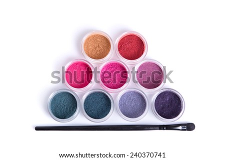 Top view of mineral eye shadows and brush, isolated on white background with natural shadow  - stock photo
