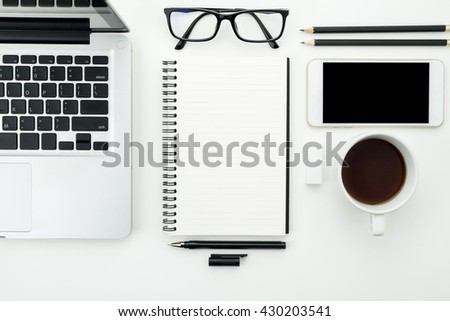 Top view of modern working table with IT and office supplies. - stock photo
