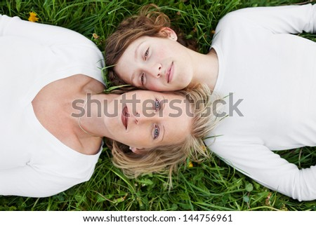 top view of mother and daughter lying head to head - stock photo