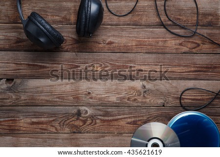 top view of music cd player equipment on wooden desk - stock photo