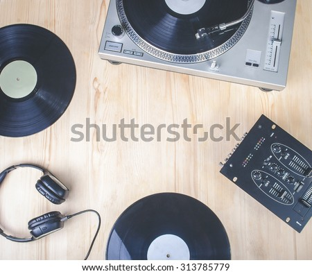 top view of music player equipment on wooden desk - stock photo