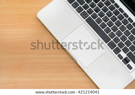 Top view of Notebook (laptop computer) on workspace of wooden table. Concept for office workplace, freelance, work, job, planning, relax, blogger, busy, social, programmer, programing, background, - stock photo