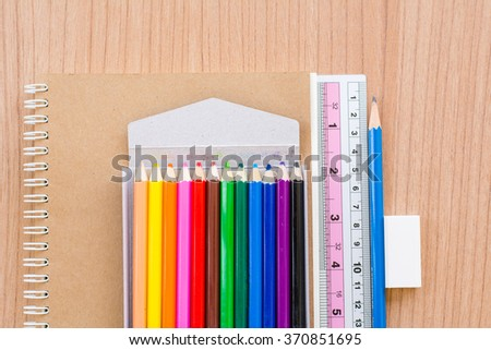 Top view of office stationery on wooden table background