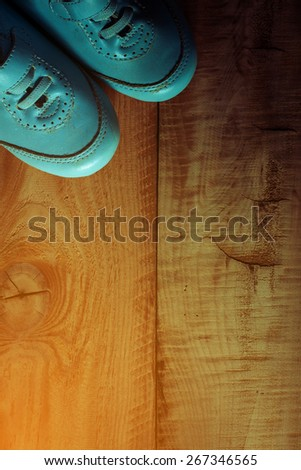 top view of old boy shoes under shadow of window light on wooden floor ,abstract background to first step concept.vintage color photo. - stock photo