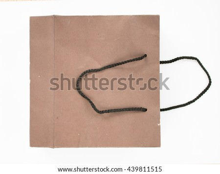 Top view of old brown paper bag isolated on white background.