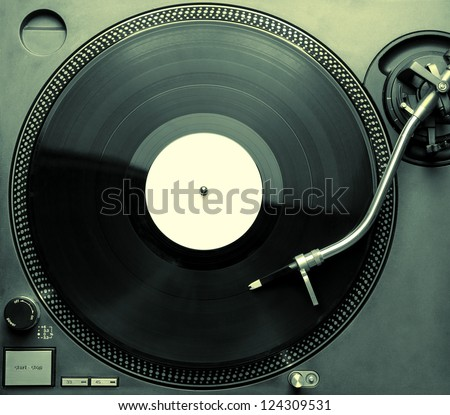 Top view of old fashioned turntable playing a track from black vinyl. Copy space for text - stock photo