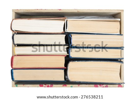 Top view of old used hardback books isolated on white.  Back to school. Reading are essential for self improvement, gaining knowledge and success in our careers, business and personal lives - stock photo