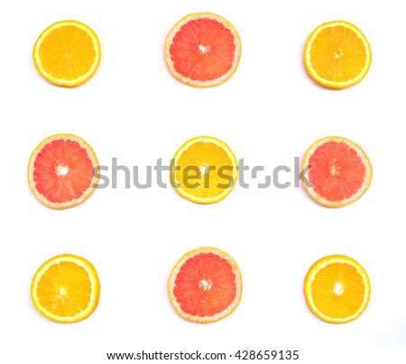 Top view of orange, grapefruit slices on white background - stock photo