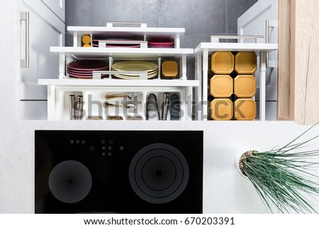 Top view organized kitchen drawers electric stock photo image top view of organized kitchen drawers and electric kitchen stove modern kitchen organization of spaces workwithnaturefo